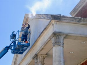 power washing cast stone as part of a building restoration