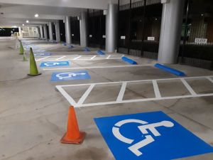 Handicap parking spaces, ADA compliance, parking lot striping