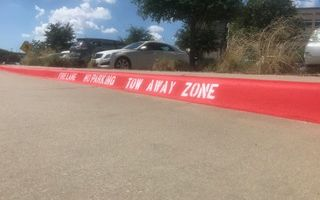 New striping of fire lane on curb